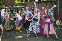 Welcome to the Oregon Country Fair. VENETA, OREGON - JULY 11, 2010: A group of singing dancers greet visitors to the Oregon Country Fair outside of Eugene Stock Photos