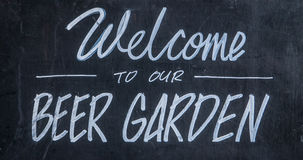 Welcome To Our Beer Garden. A Blackboard Sign Outside A Bar Or Pub Saying Welcome To Our Beer Garden royalty free stock photo