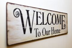 Welcome to Our Home Print Brown Wooden Wall Decor Stock Images