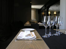 Welcome to our Restaurant!. Table of a restaurant, waiting for visitors. Glasses, blanket , knife and a plate Stock Images