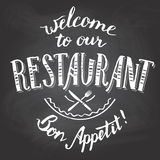 Welcome to our restaurant chalkboard printable. Welcome to our restaurant. Bon appetit. Hand-lettering and calligraphy greeting chalkboard printable Stock Photo