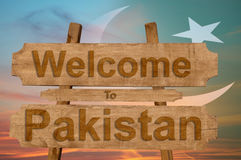 Welcome to Pakistan sign on wood background with blending national flag Stock Photography