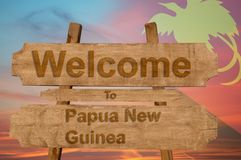 Welcome to Papua New Guinea sign on wood background with blending national flag Royalty Free Stock Photos