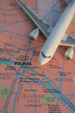 Welcome to Paris. Toy plane on top of a map of Paris Stock Photos