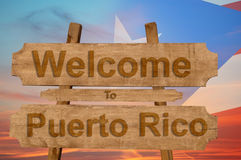 Welcome to Peurto Rico sign on wood background with blending national flag Royalty Free Stock Image
