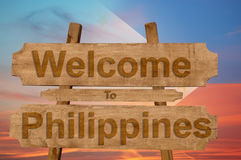Welcome to Philippines sign on wood background with blending national flag Royalty Free Stock Photos