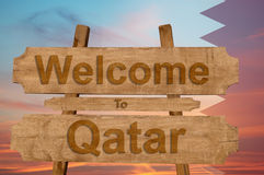 Welcome to Qatar sign on wood background Stock Images