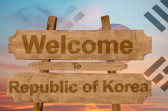 Welcome to Republic of Korea sign on wood background with blending national flag Royalty Free Stock Photography