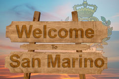 Welcome to San Marino sign on wood background with blending nationa. L flag Stock Photo