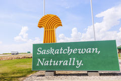 Welcome to Saskatchewan - sign and flags stock photo