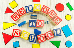 Welcome to school written in wooden cubicle letters Royalty Free Stock Photo