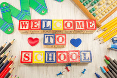 Welcome to school written in wooden cubicle letters Stock Image