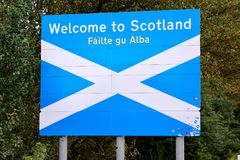 """""""Welcome to Scotland"""" road sign on the border between Englan stock photos"""