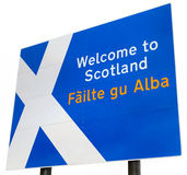 Welcome to Scotland Sign. A sign on the border crossing to Scotland from England.  Contains the Scottish flag and Welcome to Scotland in English and Gaelic Royalty Free Stock Photos