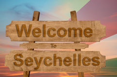 Welcome to Seychelles sign on wood background with blending national flag Stock Images