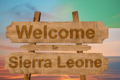 Welcome to Sierra Leone sign on wood background with blending national flag Stock Photos