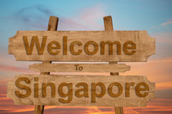Welcome to Singapore sign on wood background Stock Images