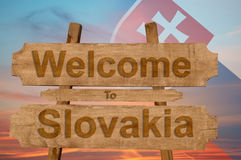 Welcome to Slovakia sign on wood background with blending national flag Royalty Free Stock Images