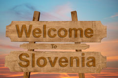 Welcome to Slovenia sign on wood background Royalty Free Stock Images