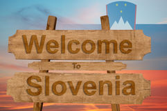 Welcome to Slovenia sign on wood background with blending nationa. L flag stock photography