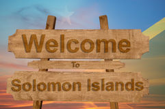 Welcome to Solomon Islands sign on wood background with blending national flag Royalty Free Stock Image