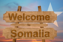 Welcome to Somalia sign on wood background with blending nationa Stock Photos