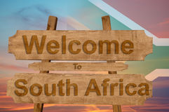 Welcome to South Africa sign on wood background with blending national flag Royalty Free Stock Photos