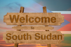 Welcome to South Sudan sign on wood background with blending nationa Royalty Free Stock Image