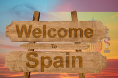 Welcome to Spain sign on wood background with blending nationa Royalty Free Stock Photos
