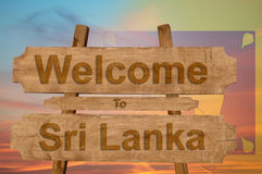 Welcome to Sri Lanka sign on wood background with blending national flag Royalty Free Stock Image