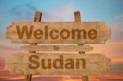 Welcome to Sudan sign on wood background Stock Images
