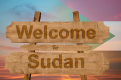 Welcome to Sudan sign on wood background with blending nationa Stock Images