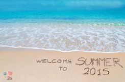 Welcome to summer 2015 written on a tropical beach Royalty Free Stock Photography