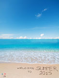 Welcome to summer 2015 written on a tropical beach Stock Images