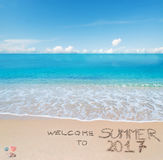 Welcome to summer 2017 written on a tropical beach Royalty Free Stock Photos