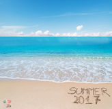 Welcome to summer 2017 written on a tropical beach Royalty Free Stock Images