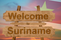 Welcome to Suriname sign on wood background with blending nationa Stock Images