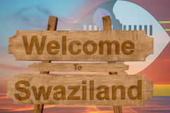 Welcome to Swaziland sign on wood background with blending nationa Royalty Free Stock Images