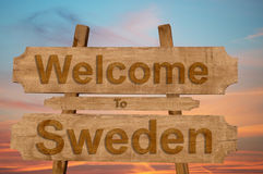 Welcome to Sweden sign on wood background Royalty Free Stock Images