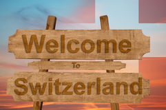 Welcome to Switzerland sign on wood background with blending national flag Stock Photography