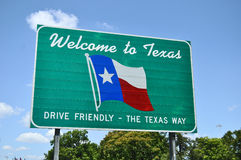 Welcome to Texas road sign. A Welcome to Texas road sign set against a light blue background showing the state flag Stock Images