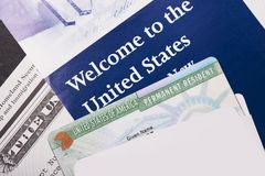 Welcome to the USA. Immigration Welcome Letter and Green Card Closeup. United States Homeland Security Stock Image