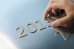 Welcome to year 2013. Hand adjusting the year number to 2013 stock images