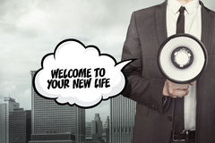 Welcome to your new life text on speech bubble with businessman and megaphone Stock Image