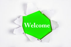 Welcome under paper Royalty Free Stock Photo