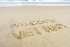 Welcome Vietnam written in sand Royalty Free Stock Image