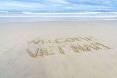 Welcome Vietnam written in sand Stock Photos