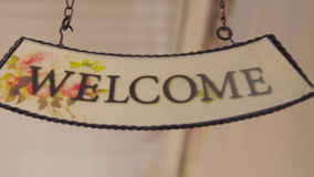 Welcome. Welcome sign isolated on white background. Hanging welcome sign. stock video footage