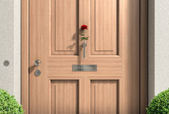 Welcome wooden door with red rose Stock Images