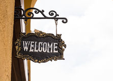 Welcome wooden sign board with rope hanging in front of the gate Royalty Free Stock Photography